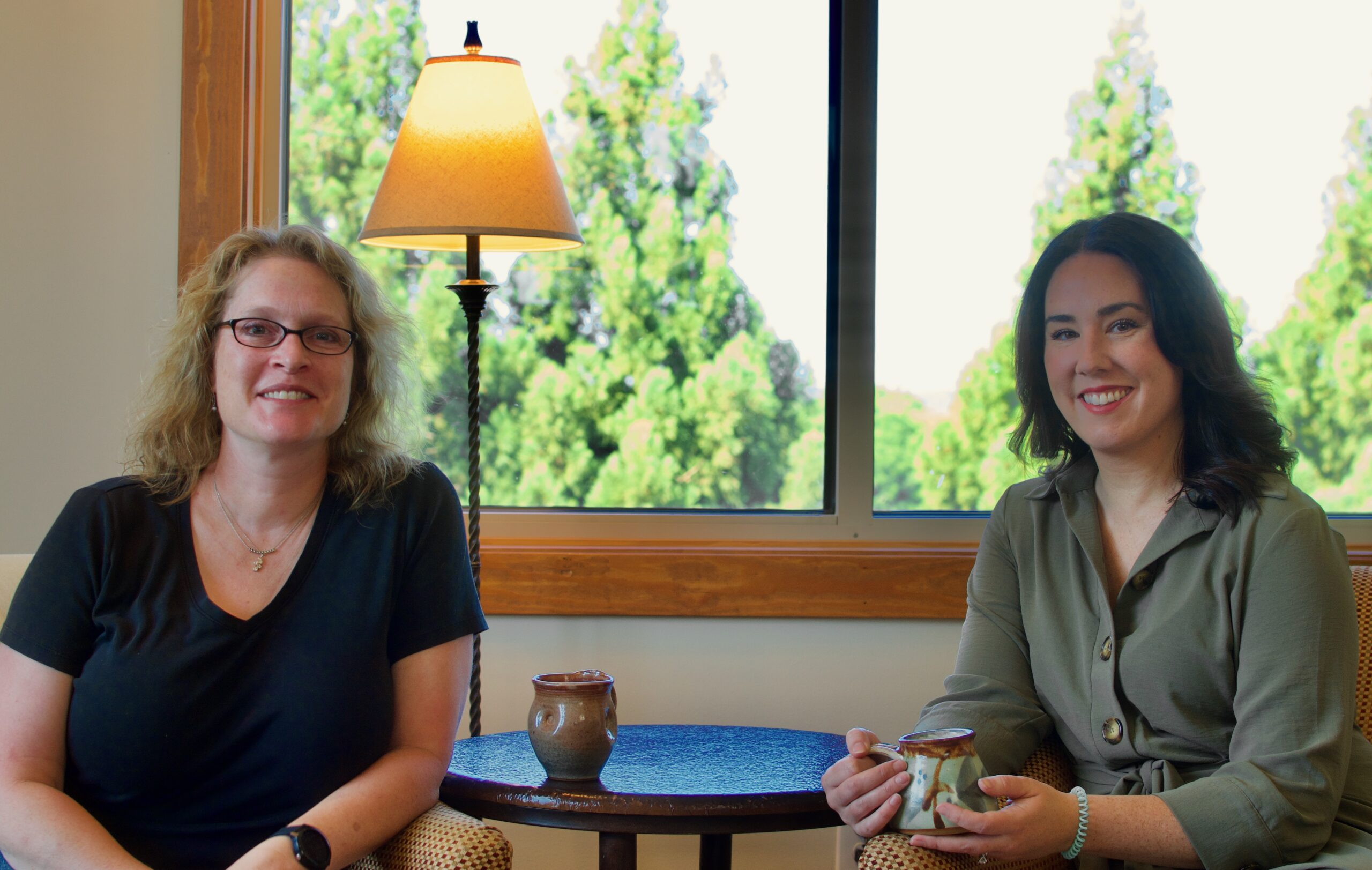 Maryfrances and Alison having coffee and talking about ImpactStory and how much easier it makes program evaluation and storytelling with data for small-and medium-sized nonprofits